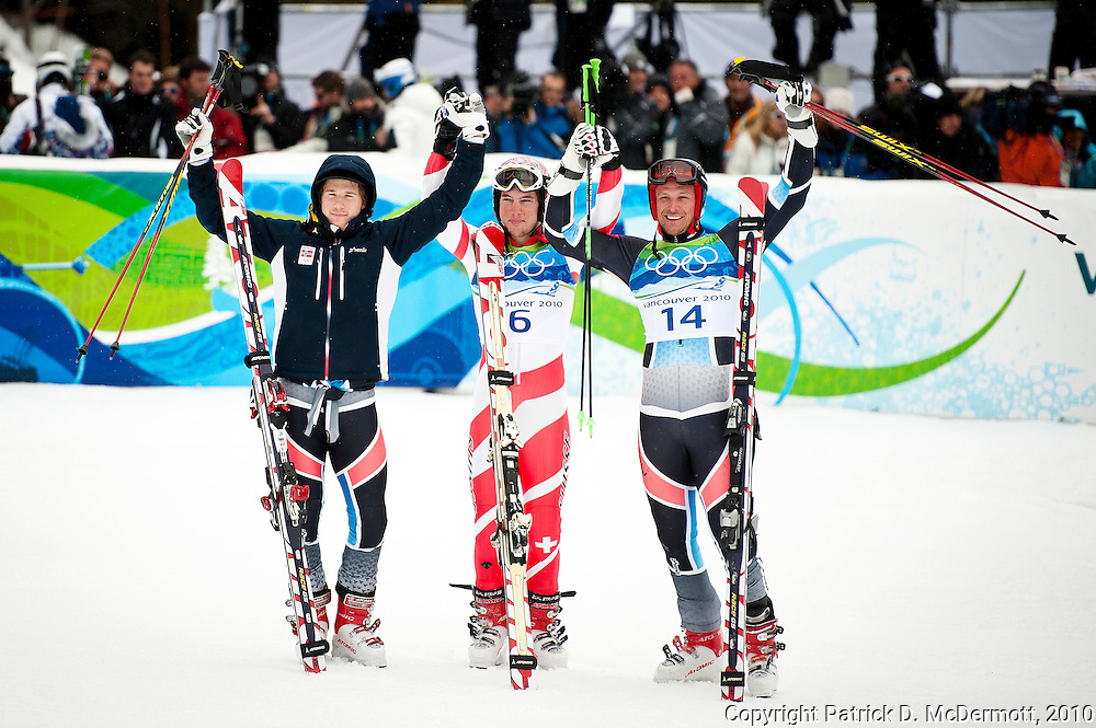 (L-R) Kjetil Jansrud of Norway, Carlo Janka of Switzerland and Aksel Lund Svindal of Norway celebrate after the second run during the Alpine Skiing Men's Giant Slalom on day 12 of the Vancouver 2010 Winter Olympics at Whistler Creekside on February 23, 2010 in Whistler, Canada.