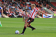 Danny Wright scores from the penalty spot during the Vanarama National League match between Cheltenham Town and Dover Athletic at Whaddon Road, Cheltenham, England on 12 September 2015. Photo by Antony Thompson.