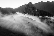 Fog rolls out over the Inca Site Machu Picchu in Peru Sunday, June 18, 2018. (Photo by AJ Mast)