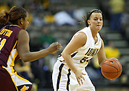 February 18, 2010: Iowa guard Megan Considine (54) drives around Minnesota guard Leah Cotton (11) during the second half of the NCAA women's basketball game at Carver-Hawkeye Arena in Iowa City, Iowa on February 18, 2010. Iowa defeated Minnesota 75-54.
