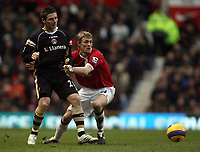 Photo: Paul Thomas.<br /> Manchester United v Charlton Athletic. The Barclays Premiership. 10/02/2007.<br /> <br /> Bryan Hughes (L) passes in front of Utd's Darren Fletcher.
