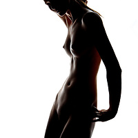 Nude woman poses in semi sillhouette