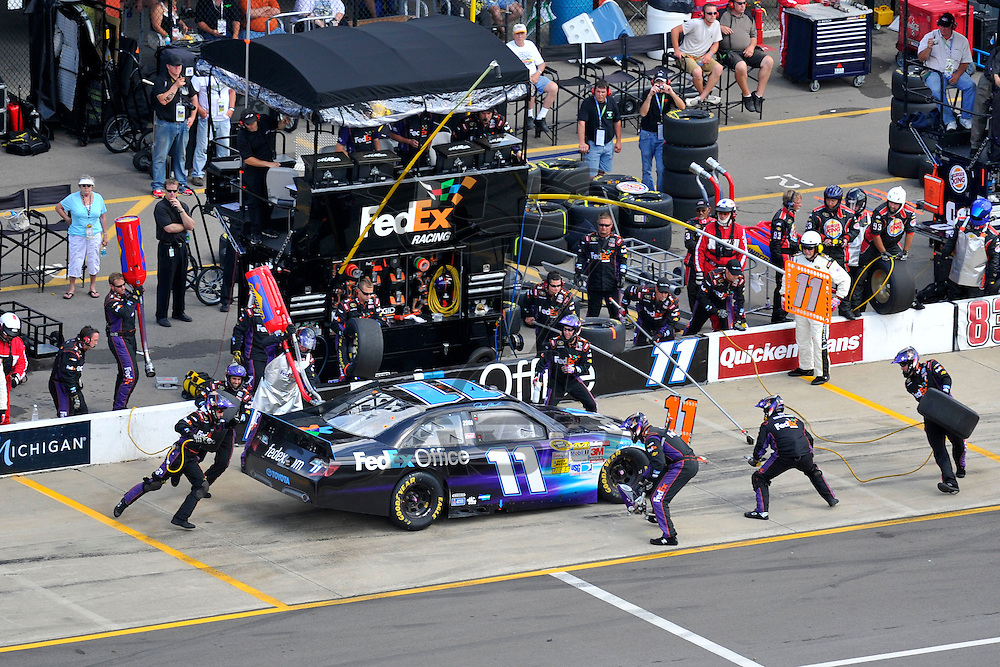 Brooklyn, MI - JUN 17, 2012: Denny Hamlin (11) makes pit stop during race action for the Quicken Loans 400 race at the Michigan International Speedway in Brooklyn, MI.