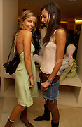 Jessica Simon ( green) and Zara Simon, Burberry party to launch collection in  support of Breakthrough Breast Cancer. New Bond St. shop. Londddon. 5 October 22004. ONE TIME USE ONLY - DO NOT ARCHIVE  © Copyright Photograph by Dafydd Jones 66 Stockwell Park Rd. London SW9 0DA Tel 020 7733 0108 www.dafjones.com