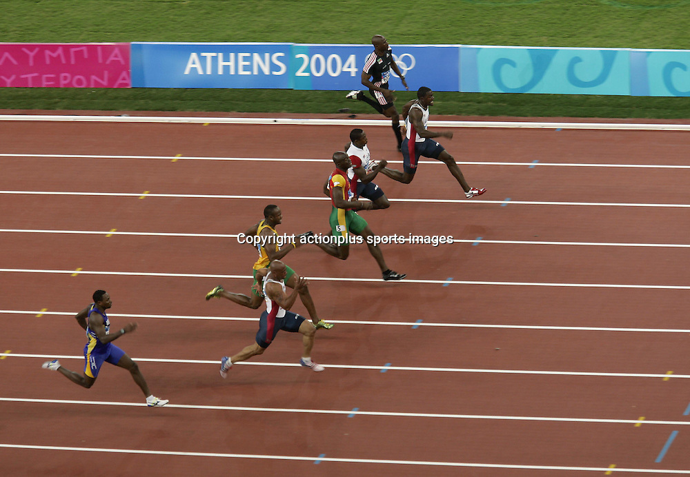 22 August 2004: Elevated view of American sprinter JUSTIN GATLIN (USA) on the far side, leading the field on his way to victory in the Men's 100m Final. FRANCIS OBIKWELU (POR) comes second, MAURICE GREENE (USA) third. GATLIN won in a time of 9.85 at The 2004 Olympic Games, Athens, Greece. Photo: Glyn Kirk/Action Plus/Photosport<br /> <br /> <br /> <br /> 040822 olympics sprinting sprinters