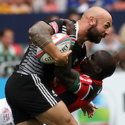 NZ Sevens Captain, DJ Forbes powers over a Kenyan during day 2 of the Hong Kong Sevens Rugby, Hong Kong Stadium, Hong Kong, 3/23/13.  Photo by Barry Markowitz
