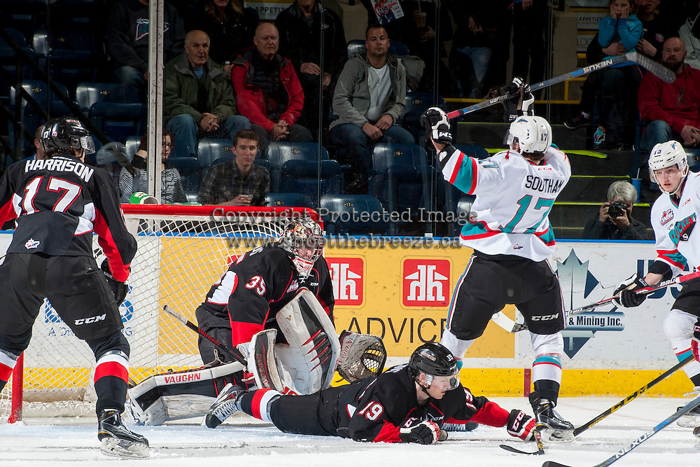 KELOWNA, CANADA - MARCH 9: Ty Edmonds #35 of Prince George Cougars defends the net against a shot by Rodney Southam #17 of the Kelowna Rockets on March 9, 2016 at Prospera Place in Kelowna, British Columbia, Canada.  (Photo by Marissa Baecker/Shoot the Breeze)  *** Local Caption *** Rodney Southam; Ty Edmonds;