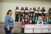 Michelle Eacret thanks Girl Scouts for their hard work in creating more than 6,000 Holiday Cards special for the U.S. Military during the Girl Scout USA of Northern California Operation Holiday Cards packing event at Mount Olive Ministries in Milpitas, California, on November 18, 2015. Eacret started Operation Holiday Cards 13 years ago. (Stan Olszewski/SOSKIphoto)
