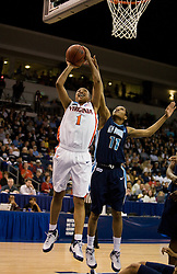 Virginia forward Lyndra Littles (1) shoots past Old Dominion forward Shahida Williams (11).  The #11 ranked / #5 seed Old Dominion Lady Monarchs defeated the #24 ranked / #4 seed Virginia Cavaliers 88-85 in overtime in the second round of the 2008 NCAA Women's Basketball Championship at the Ted Constant Convocation Center in Norfolk, VA on March 25, 2008.