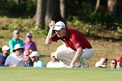 August 9, 2018 - St. Louis, Missouri, United States - Justin Rose lines up a putt during the first round of the 100th PGA Championship at Bellerive Country Club. (Credit Image: © Debby Wong via ZUMA Wire)