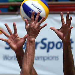 DURBAN, SOUTH AFRICA - DECEMBER 14: Hands during the Men's second semi-final between Bruno Oscar Schmidt and Pedro Solberg Salgado of Brazil and Aleksandrs Samoilovs and Janis Smedins of Latvia at the FIVB Durban Open at New Beach on December 14, 2013 in Durban, South Africa.  (Photo by Steve Haag/Getty Images for FIVB)