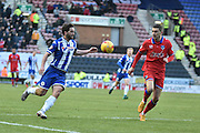 Wigan Athletic Forward, Will Grigg and currently Wigans leading Goal scorer looking to make a break during the Sky Bet League 1 match between Wigan Athletic and Oldham Athletic at the DW Stadium, Wigan, England on 13 February 2016. Photo by Mark Pollitt.
