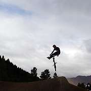 Paul Langland in action during the 'Red Bull Roast It' BMX competition with riders from around the globe competing at the Gorge Road Jump Park, Queenstown, South Island, New Zealand. 18th February 2012. Photo Tim Clayton