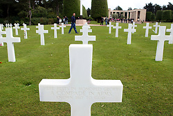 At the conclusion of the fighting in Normandy, there were more than ten American cemeteries on the battlefield, with hundreds of small burial grounds and isolated graves. The American Battle Monuments Commission (AMBC) repatriated at least 60% of these burials back to the United States, and concentrated the remaining casualties into two main cemeteries; one in Normandy and another in Britian.  To a size of 172.5 acres, the Normandy American Cemetery has 9,387 burials of US service men and women. Of this number, some 307 are unknowns, three are Medal of Honor winners and four are women. In addition there are 33 pairs of brothers buried side by side. It is the largest American Cemetery from WW2, but not the largest in Europe: that is the Meuse-Argonne Cemetery from WW1 with more than 14,000 burials.