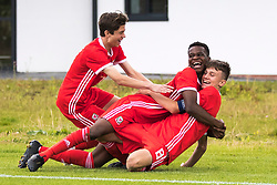 WREXHAM, WALES - Tuesday, August 13, 2019: Wales' captain Ben Lloyd celebrates scoring the first goal during the UEFA Under-15's Development Tournament match between Wales and Cyprus at Colliers Park with Calum Agius and Japhet Matondo (Pic by Paul Greenwood/Propaganda)