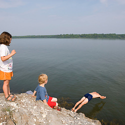 A dad goes for a swim as his kids watch on in Marquoit Bay, Brunswick, Maine.