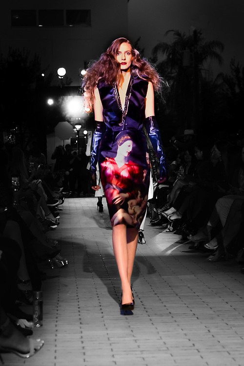 Selective color photograph of model Katherine Azbil on the runway for Kate Kills Pretty.