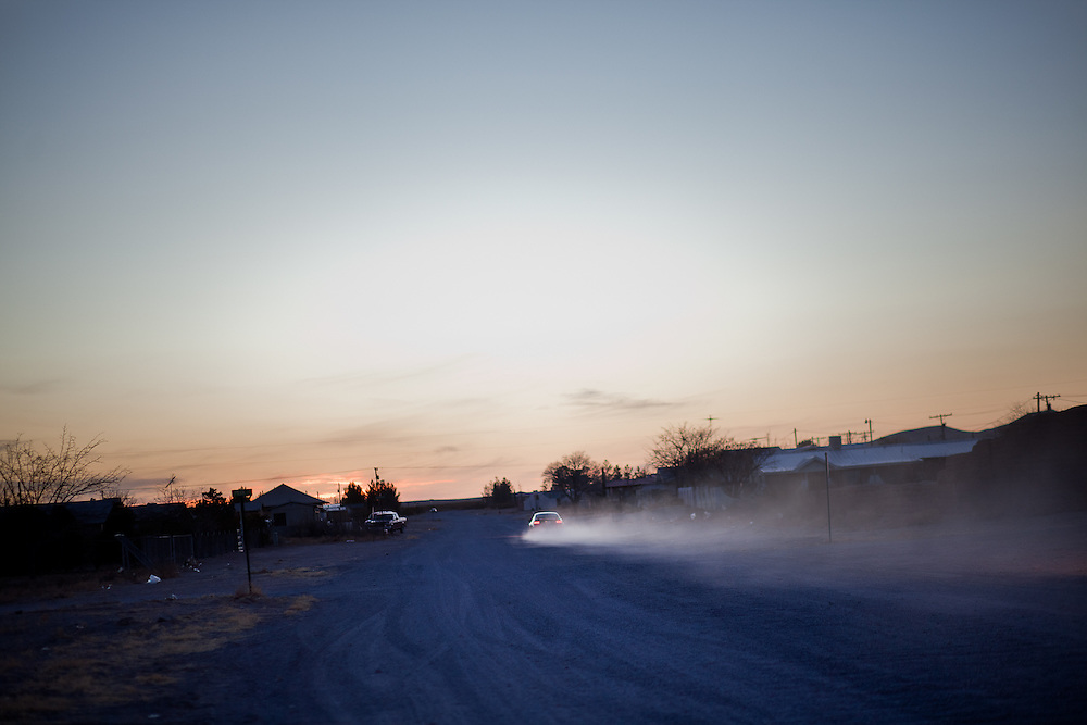A car kicks up dust in Columbus, New Mexico. Recently federal authorities arrested the mayor, police chief, and trustees who were allegedly operating an illegal gun running ring.