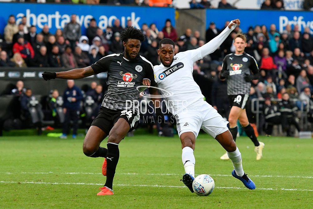 Tyler Blackett (24) of Reading battles for possession with Leroy Fer (8) of Swansea City during the EFL Sky Bet Championship match between Swansea City and Reading at the Liberty Stadium, Swansea, Wales on 27 October 2018.