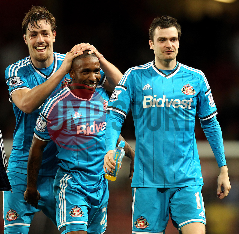 Sunderland's Jermain Defoe Sunderland's Adam Johnson and Sunderland's Sebastian Coates celebrate staying up - Photo mandatory by-line: Robbie Stephenson/JMP - Mobile: 07966 386802 - 20/05/2015 - SPORT - Football - London - Emirates Stadium - Arsenal v Sunderland - Barclays Premier League