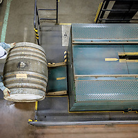 A worker moves a barrel at the Yamazaki Distillery in Yamazaki, Osaka Prefecture, Japan, November 6, 2015. Gary He/DRAMBOX MEDIA LIBRARY