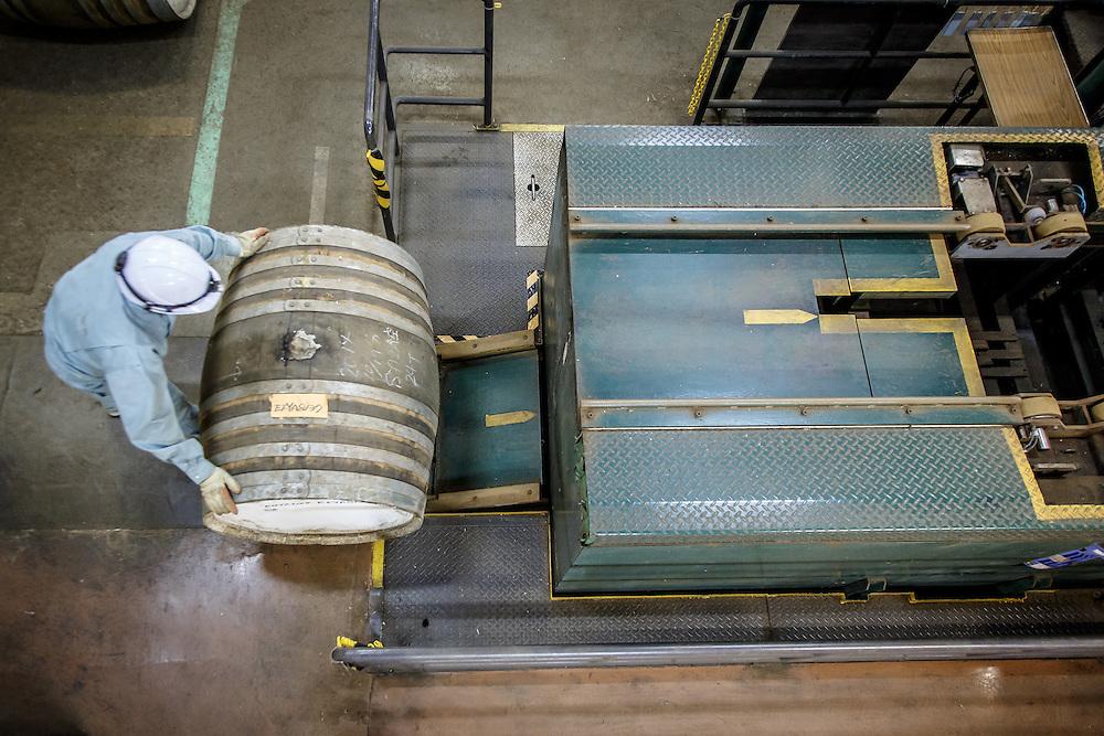A worker moves a barrel at the Yamazaki Distillery in Yamazaki, Osaka Prefecture, Japan, November 6, 2015. Gary He/DRAMBOX MEDIA LIBRARY