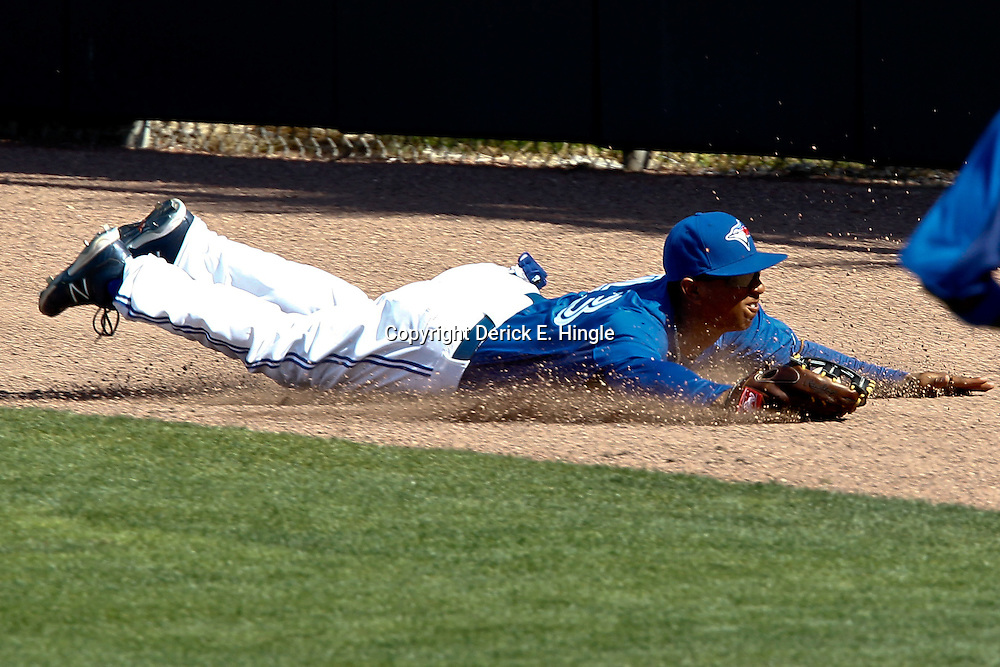 March 8, 2011; Dunedin, FL, USA; Toronto Blue Jays center fielder Anthony Gose (43) dives and catches a fly ball by New York Yankees third baseman Bill Hall (40) to end the top of the sixth inning of a spring training game at Florida Auto Exchange Stadium. Mandatory Credit: Derick E. Hingle-US PRESSWIRE