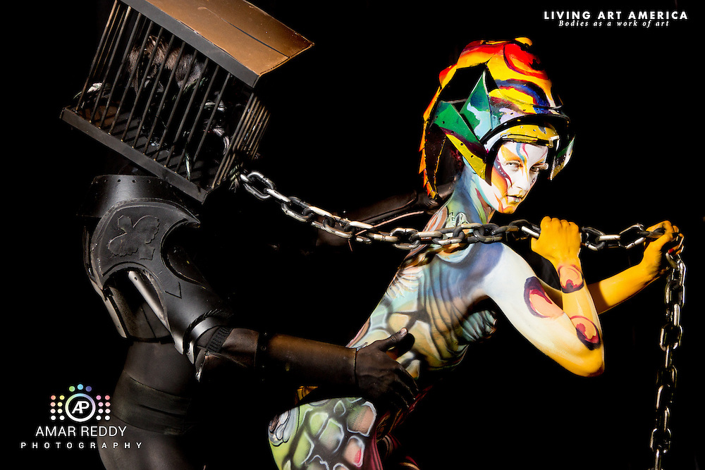 Living Art America::The Bodies Works of Art::The North American Body Painting Championship | A World Body-painting Association Sanctioned Event <br /> <br /> Artist: Roberto Hernandez, Models:&nbsp;Kristina Guede and Tony Schott,<br /> Photographer: Amar Reddy<br /> <br /> www.livingartamerica.com<br /> www.AmarPhotography.com