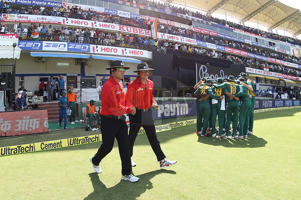 The umpires take to the field during the 2nd Paytm Freedom Trophy Series One Day International ( ODI ) match between India and South Africa held at the Holkar Stadium in Indore, India on the 14th October 2015<br /> <br /> Photo by Ron Gaunt/ BCCI/ Sportzpics