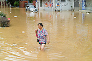 FUZHOU, CHINA - SEPTEMBER 15: <br /> <br /> A woman walks in a flooded road after Typhoon Meranti on September 15, 2016 in Fuzhou, Fujian Province of China. Typhoon Meranti made landfall in Xiamen at 3:05 a.m on Thursday and caused damage in Fujian.<br /> ©Exclusivepix Media