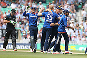England Ben Stokes is congratulated after his wicket of New Zealand Martin Guptill during the Royal London One Day International match between England and New Zealand at the Oval, London, United Kingdom on 12 June 2015. Photo by Phil Duncan.