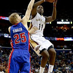 Dec 11, 2013; New Orleans, LA, USA; New Orleans Pelicans point guard Jrue Holiday (11) is defended by \d23\ during the second quarter at New Orleans Arena. Mandatory Credit: Derick E. Hingle-USA TODAY Sports