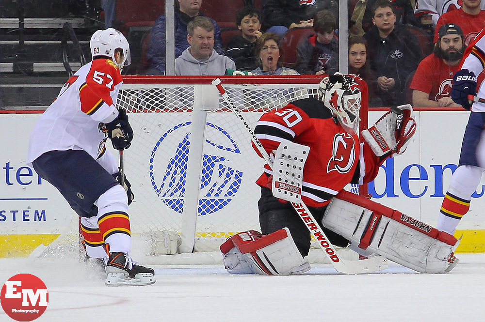 Mar 23, 2013; Newark, NJ, USA; New Jersey Devils goalie Martin Brodeur (30) makes a save during the first period of their game against the Florida Panthers at the Prudential Center.