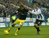 Photo: Aidan Ellis.<br /> Sheffield Wednesday v Birmingham City. Coca Cola Championship. 16/12/2006.<br /> Birmingham's Nicklas Bendtner holds off Sheffield's Chris Brunt