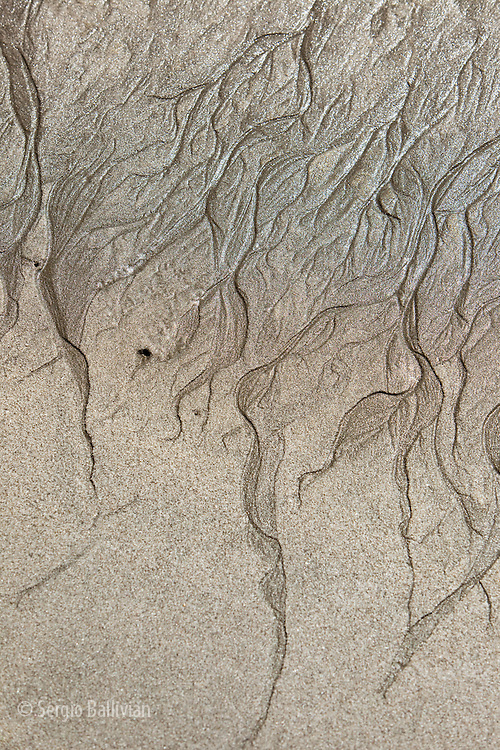 At low tide the sand exposes patterns and intricate shapes along the northeast coast of New Zealand's North Island.   The northern coast bordering on the Bay of Plenty have extensive uncrowded beaches and spectacular coastline that offer solitude and sunshine.