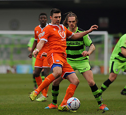 Forest Green Rovers's Tom Bender challenges for the ball against Braintree Town's Sean Marks - Photo mandatory by-line: Nizaam Jones - Mobile: 07966 386802 - 14/03/2015 - SPORT - Football - Nailsworth - The New Lawn - Forest Green Rovers v Braintree  - Vanarama Football Conference.