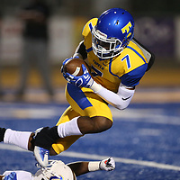 Tupelo's Fabian Perry makes a catch during Friday night's game against Oxford.