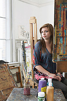 Portrait of young female student in art studio