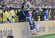 HOUSTON, TEXAS - JUNE 21:  Ezequiel Lavezzi #22 of Argentina flips over the boards while heading the ball during play in the second half before the Semifinal match between Argentina and US at NRG Stadium as part of Copa America Centenario US 2016 on June 21, 2016 in Houston, Texas, US. (Photo by Thomas B. Shea/LatinContent/Getty Images)