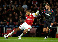 Photo: Ed Godden.<br /> Arsenal v CSKA Moscow. UEFA Champions League, Group G. 01/11/2006. Arsenal's Thierry Henry (L) has a shot on goal.