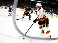 Calgary Flames forward Mikael Backlund (FRONT)  moves the puck against Anaheim Ducks during a 2017-2018 NHL hockey game in Anaheim, California, the United States, on Oct. 9, 2017.  Calgary Flames won 2-0. (Xinhua/Zhao Hanrong)