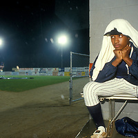 USA, Virginia,  Minor league baseball player sits in dugout during rain delay during Carolina League baseball game