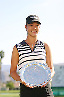 March 28, 2004; Rancho Mirage, CA, USA;  14 year old amateur Michelle Wie poses with her trophy for low amateur after the final round of the LPGA Kraft Nabisco golf tournament held at Mission Hills Country Club.  Wie finished the day with a 1 under par 71.  Her overall score of 7 under par 281 was good enough for 4th place overall.<br />Mandatory Credit: Photo by Darrell Miho <br />&copy; Copyright Darrell Miho