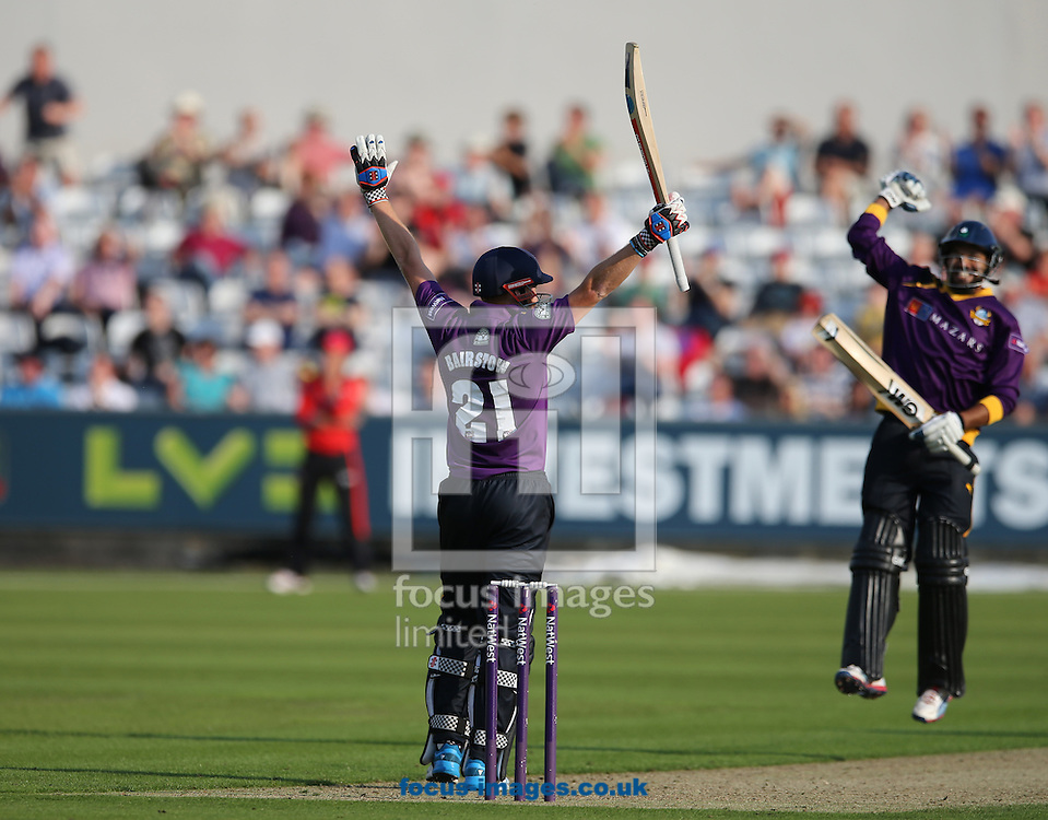 Jonathan Bairstow (l) of Yorkshire Vikings celebrates getting a century during the Natwest T20 Blast match at Emirates Durham ICG, Chester-le-Street<br /> Picture by Simon Moore/Focus Images Ltd 07807 671782<br /> 11/07/2014