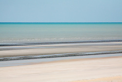 Sediment suspended in the water at Eighty Mile Beach on Mandora Station, south of Broome