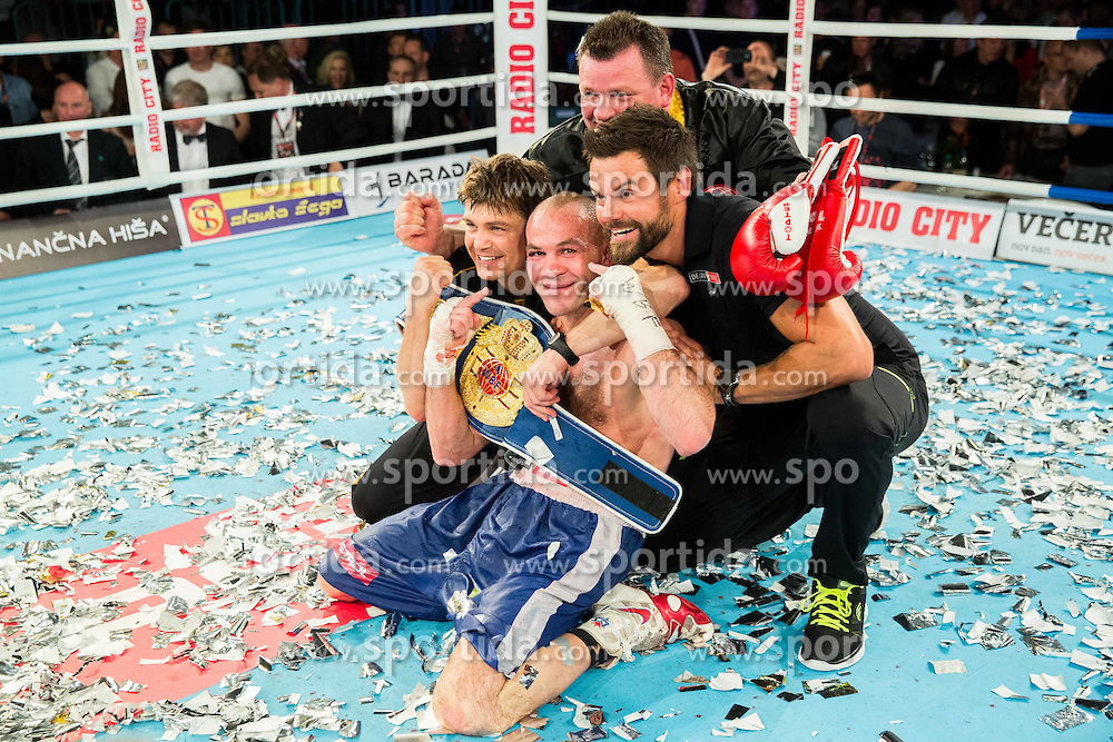 Dejan Zavec alias Jan Zaveck of Slovenia with his team Dirk Dzemski, Tomi Jagarinec celebrates after winning against WBF World Champion Sasha Yengoyan (Blue) of Belgium at Fight for World WBF Champion during First Class Boxing event, on April 11, 2015 in Arena Tabor, Maribor, Slovenia. Photo by Vid Ponikvar / Sportida