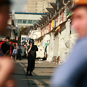 Police cordones off the Cherkizovo market in eastern Moscow soon after .an explosion killed 10 people, including two children, and injuring more than 40..Prosecutors said the attack was likely linked to organized crime, though terrorism could not be ruled out..The explosion crashed the roof of around 100 sq meters and triggering the fire.