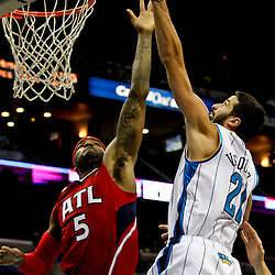 Jan 1, 2013; New Orleans, LA, USA; New Orleans Hornets point guard Greivis Vasquez (21) shoots over Atlanta Hawks small forward Josh Smith (5) during the second quarter of a game at the New Orleans Arena. Mandatory Credit: Derick E. Hingle-USA TODAY Sports