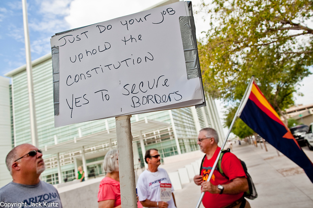 15 JULY 2010 - PHOENIX, AZ: Members of the Phoenix Tea Party gather in front of the US Courthouse Thursday morning. People for and against SB 1070 picketed the front of the Sandra Day O'Connor US Courthouse (CQ) in Phoenix Thursday morning during the first hearing against SB 1070.    PHOTO BY JACK KURTZ