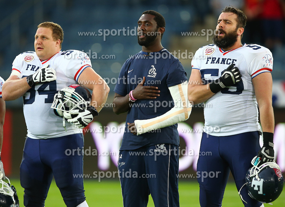 04.06.2014, UPC Arena, Graz, AUT, American Football Europameisterschaft 2014, Gruppe B, Frankreich (FRA) vs Oesterreich (AUT), im Bild Loic  Cagniard , (Team France, LB , #54), der verletzte  Giovanni  Nanguy , (Team France, LB , #45) und  Alexis  Stropiano , (Team France, OL , #59) // during the American Football European Championship 2014 group B game between France vs Austria at the UPC Arena, Graz, Austria on 2014/06/04. EXPA Pictures © 2014, PhotoCredit: EXPA/ Thomas Haumer